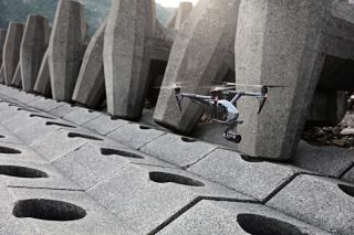 The DJI Inspire 2 drone in flight above a structure