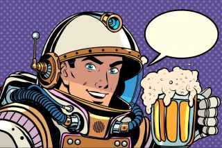 Retro astronaut and a mug of beer.