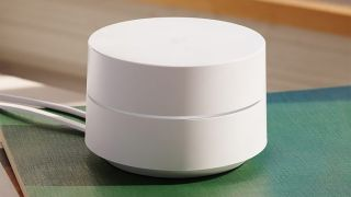 A Google Wifi Point Device Sitting On A Coffee Table