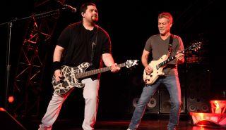 Eddie Van Halen (R) and Wolfgang Van Halen perform onstage at Nikon at Jones Beach Theater on August 13, 2015 in Wantagh, New York