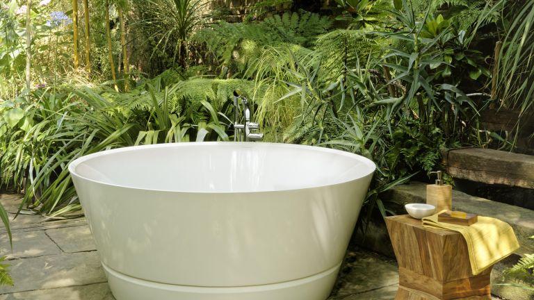 Outdoor bathtub in a garden