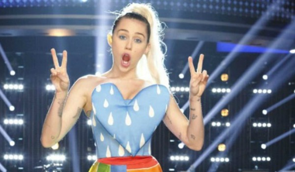 Miley Cyrus giving the peace sign