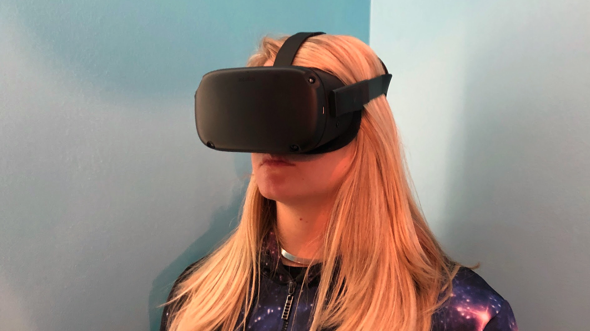 A photo of becca wearing the oculus quest vr headset