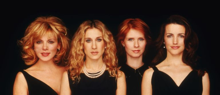 """actresses Kim Cattrall, Sarah Jessica Parker, Cynthia Nixon, and Kristin Davis pose for a portrait in an undated photo on the set of the HBO series """"Sex and the City."""""""