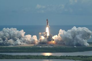 Shuttle Astronauts Launch on Ambitious Space Station Mission