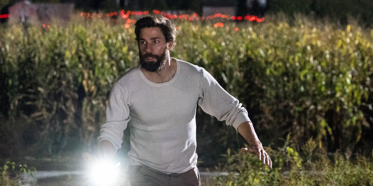 John Krasinski fleeing from the creatures in A Quiet Place