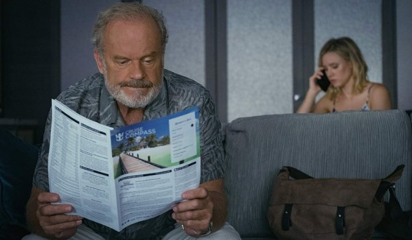 Like Father Kelsey Grammar studies a brochure while Kristen Bell takes a call
