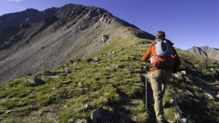 When does a hill become a mountain: A man hikes up the ridge of a mountain in Colorado