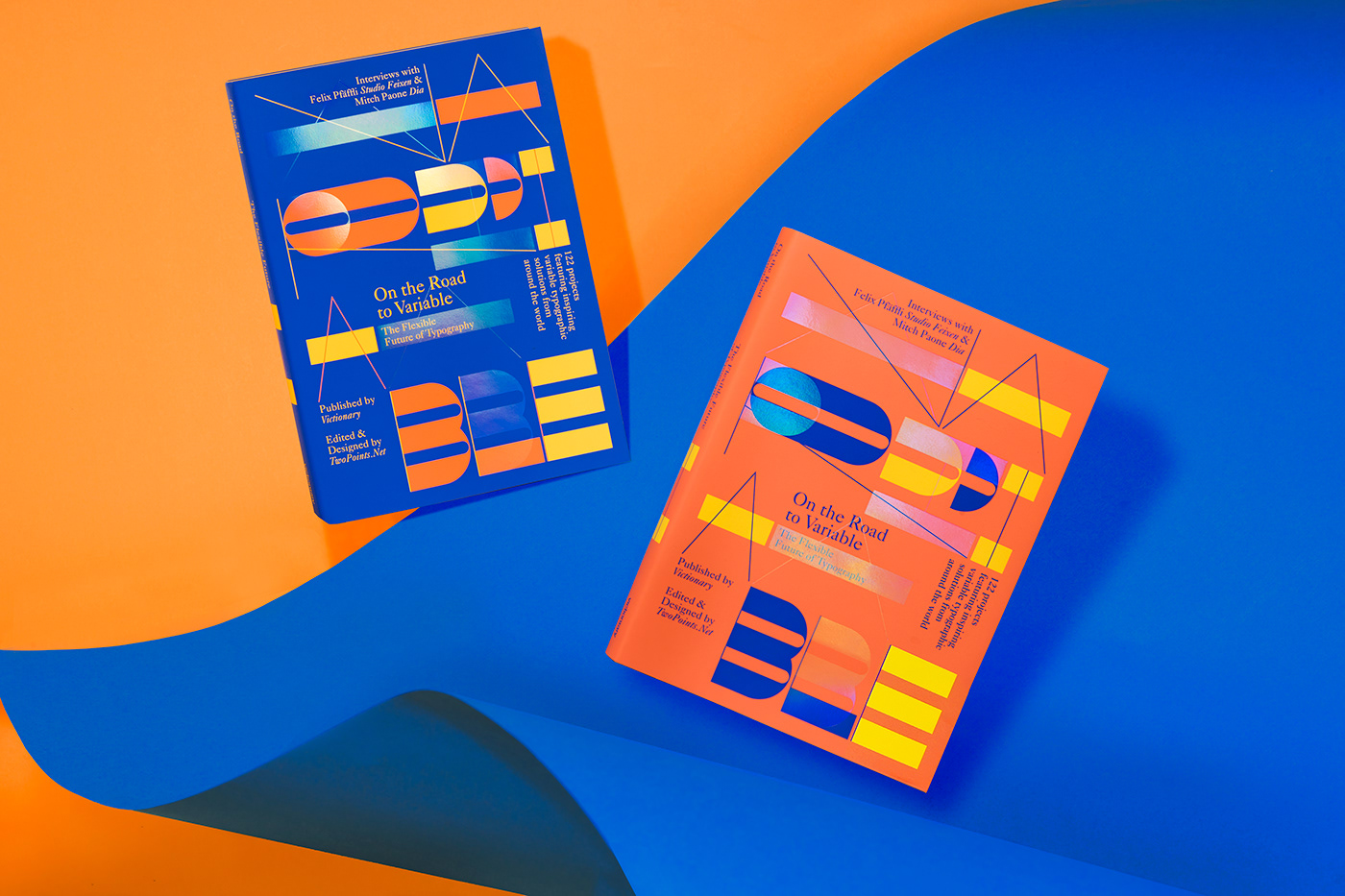Two books against an orange and blue background