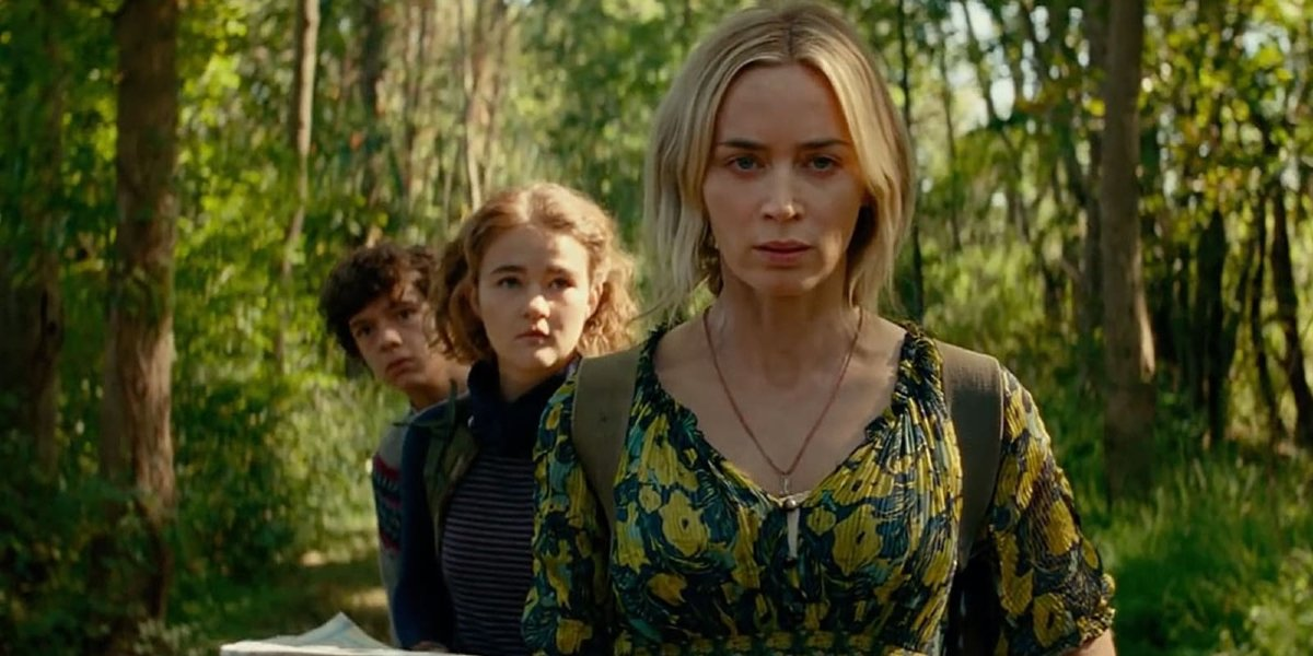 A Quiet Place Part II Emily Blunt and her on-screen children walking in the forest