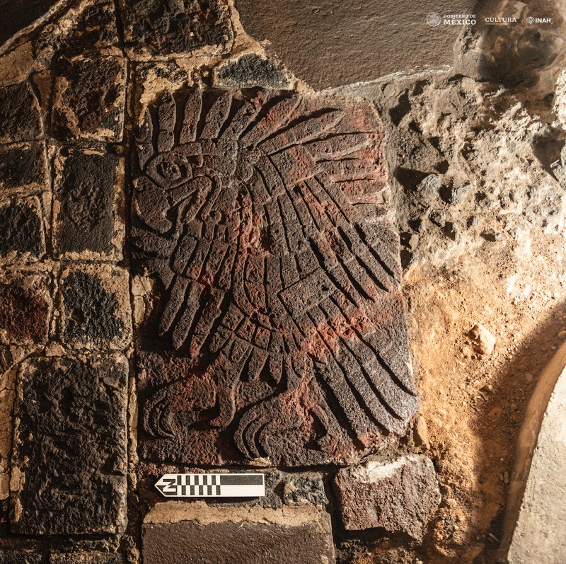 A bas-relief of a golden eagle carved into the floor near the famous Aztec site Templo Mayor