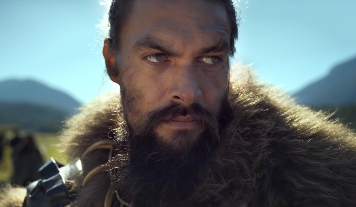 See Jason Momoa stands in the sunny, open fields