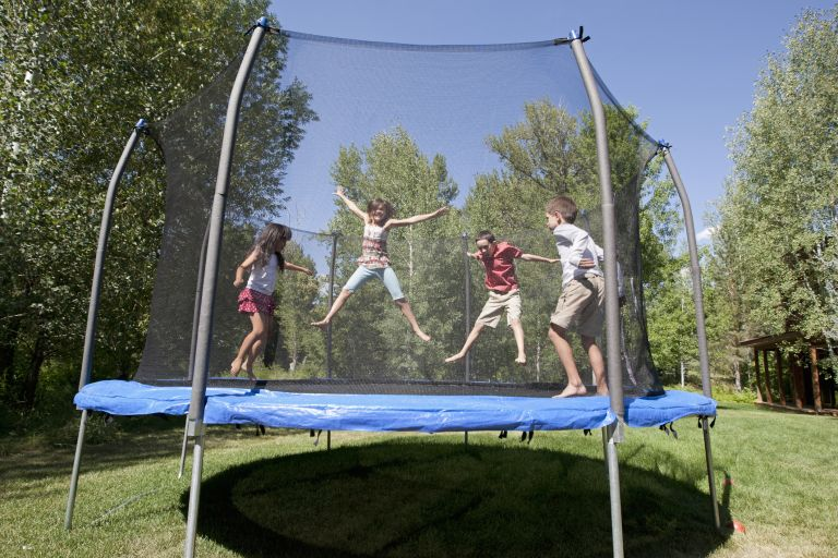 Children playing on the best trampoline with an enclosure