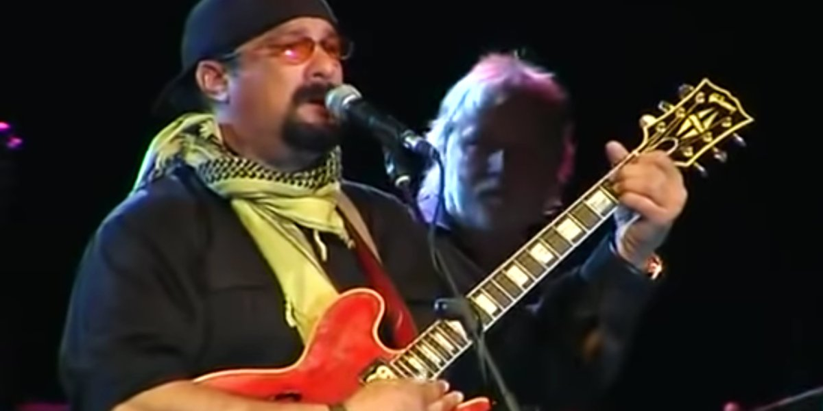 Steven Seagal playing guitar