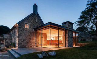 glass box extension to 17th century farmhouse