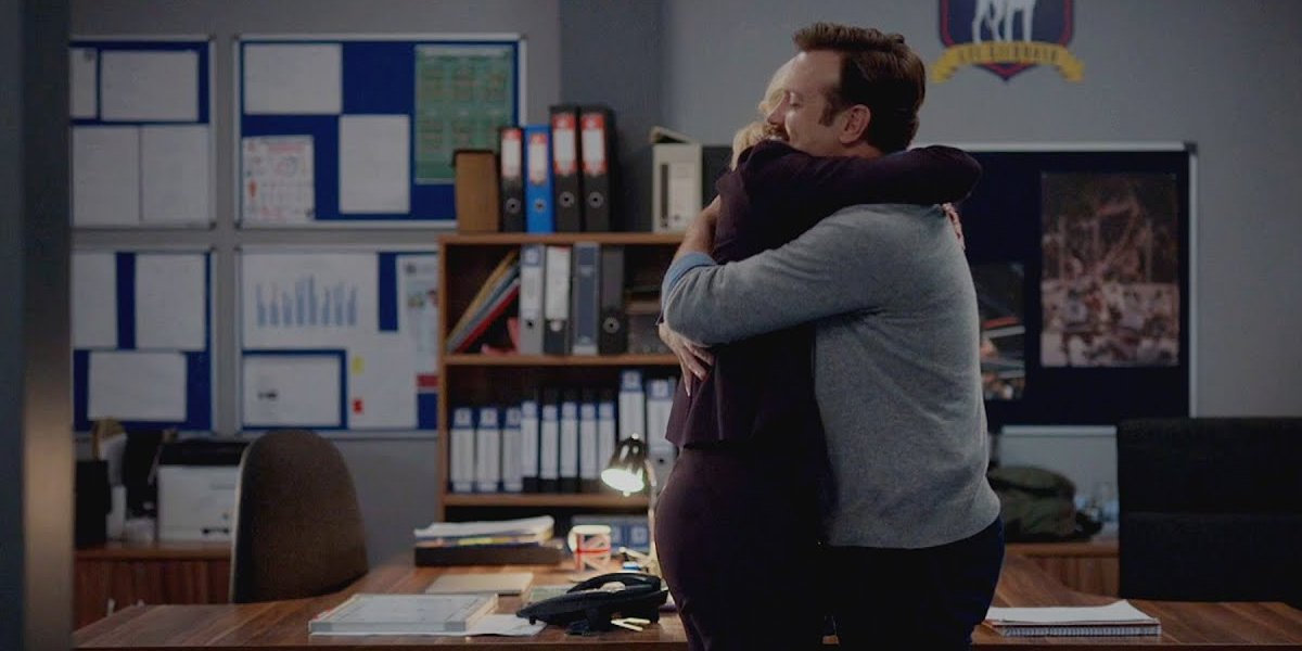 Ted hugs Rebecca in Ted Lasso.