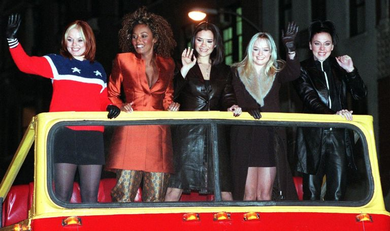 """The Spice Girls' Ginger Spice (Geraldine Halliwell) (L) -- Scary Spice (Melanie Janine Brown) (2nd from L) -- Posh Spice (Victoria Adams) (C) -- Baby Spice (Emma Lee Burton) (2nd from R) -- and Sporty Spice (Melanie Jayne Chisolm) (R) -- arrive atop a double decker bus for a screening of their new movie """"Spice World"""" at Planet Hollywood in New York 14 January."""