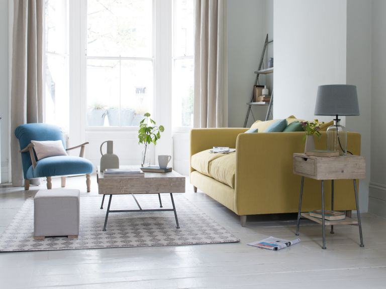 living room with white scheme and yellow sofa by loaf