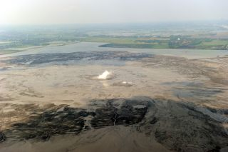 "An aerial view taken on May 26, 2010, of the ""Lusi"" mud volcano and the mud it has spewed across surrounding villages in Porong, Sidoarjo district, on East Java."