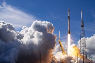 A SpaceX Falcon 9 rocket launches the SXM-7 Sirius XM radio satellite into orbit on Dec. 13, 2020. The same rocket booster will launch on its eighth flight on Jan. 18, 2020 to deliver 60 Starlink internet satellites to orbit.