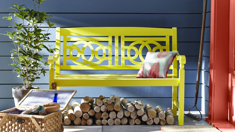 garden bench painted bright yellow