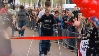 Claire Lomas, paralyzed from the waist down, finishes the London Marathon.