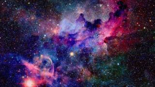 A colorful shot of nebula and stars in deep space.