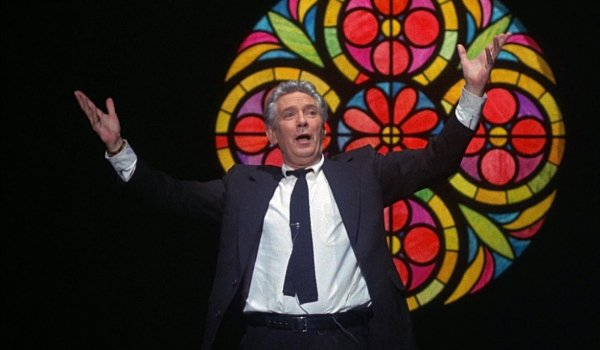 Network Howard Beale makes his witness in front of a stained glass window