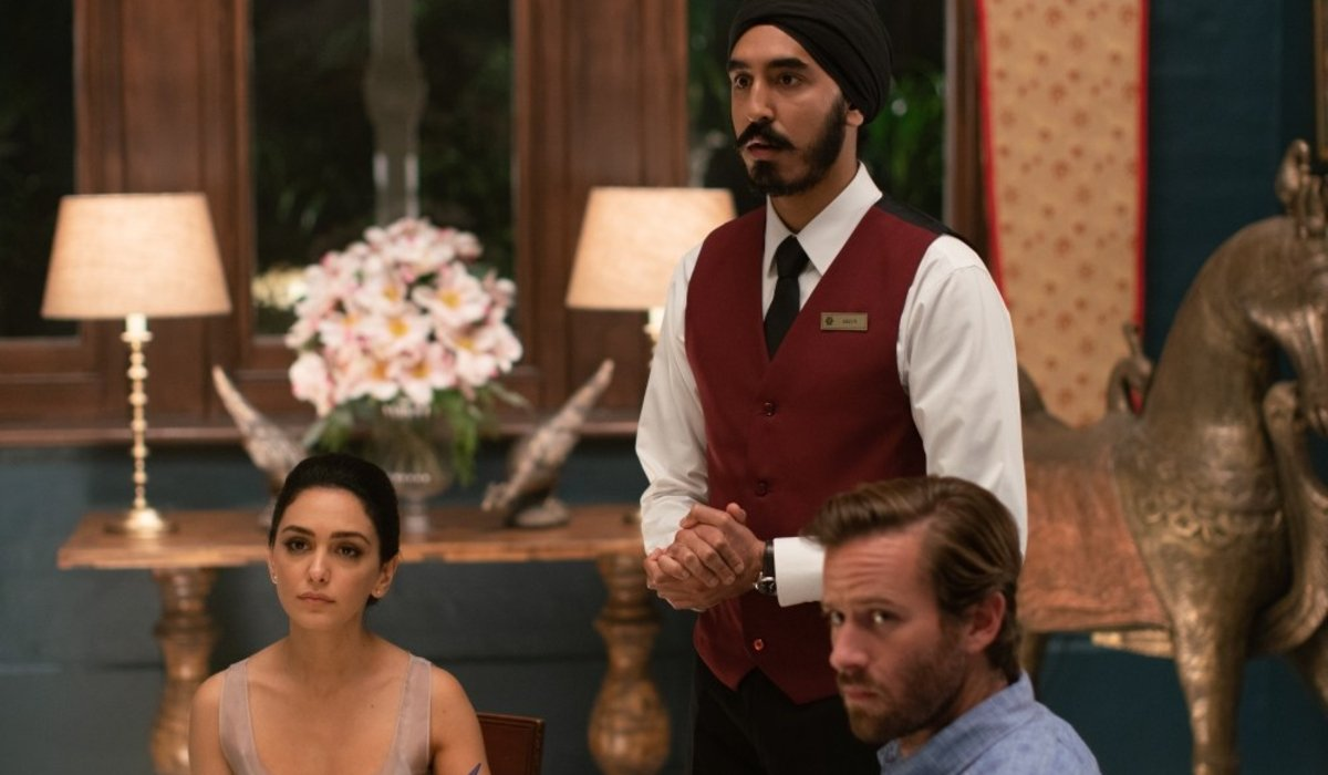 Hotel Mumbai Dev Patel, Nazanin Boniadi, and Armie Hammer look outside of the restaurant in the midd