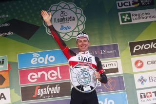 Tadej Pogacar (UAE Team Emirates) winner of the 2021 Il Lombardia celebrates on the podium