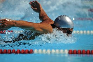 Racing the butterfly stroke.