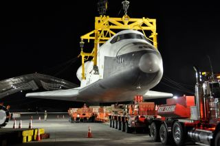 Shuttle Enterprise is de-mated from its carrier aircraft at John F. Kennedy Airport in NYC on May 12, 2012.