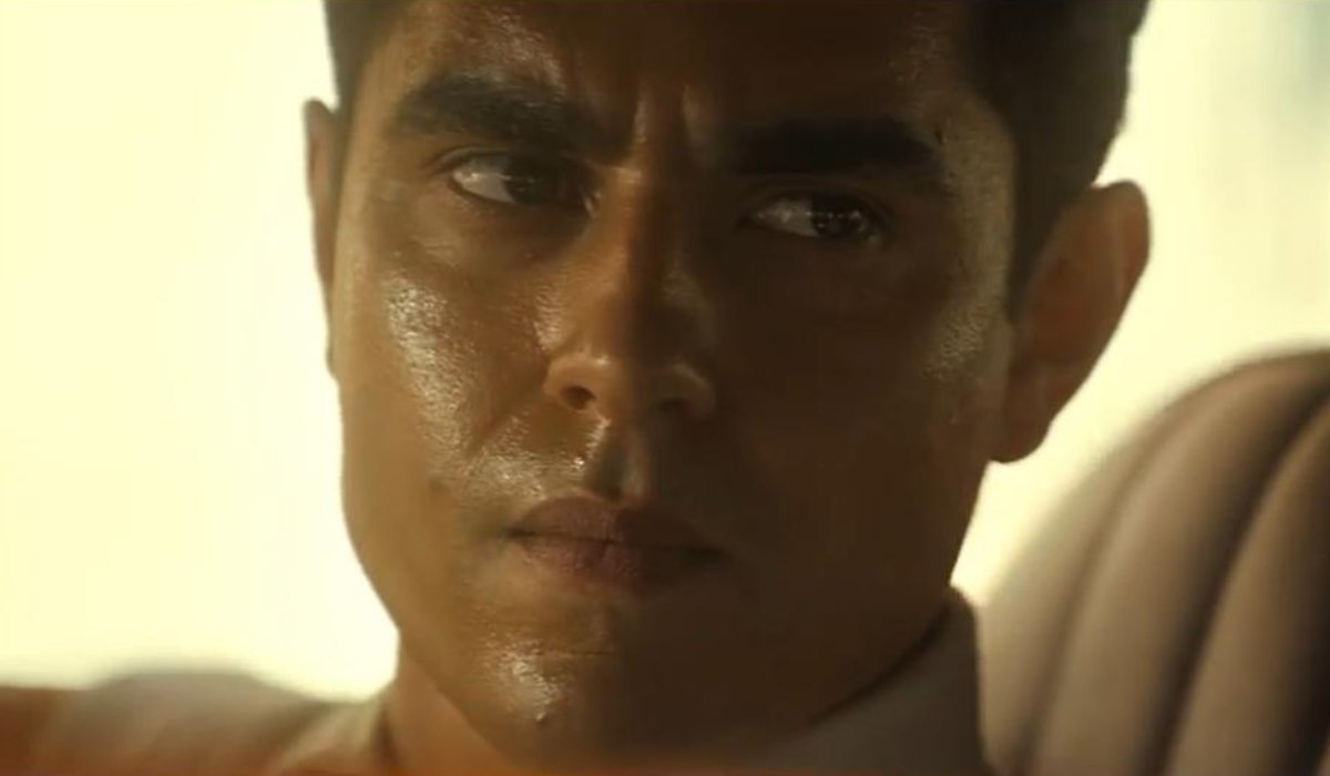 Max Minghella sitting in a hot car in Spiral: From the Book of Saw.