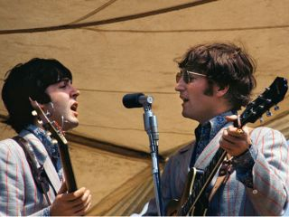 Paul and John share a mic in 66