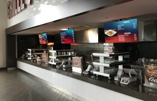 Raymond James Stadium menu boards featuring PingHD and Samsung.