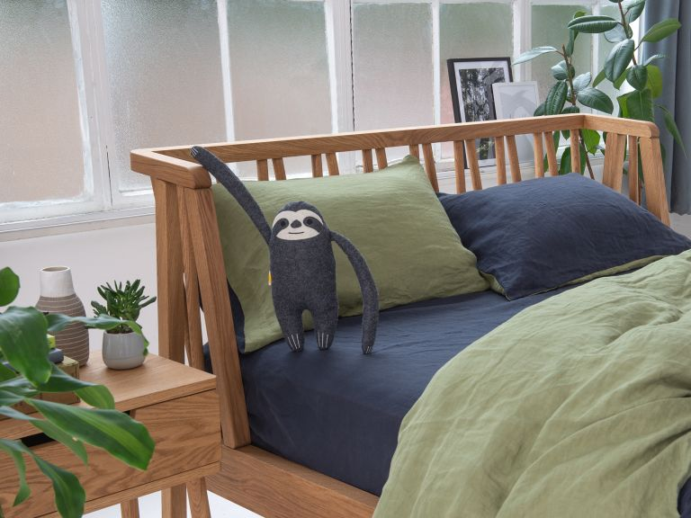Eve mattress discount code: Eve mattress on bed with sloth toy