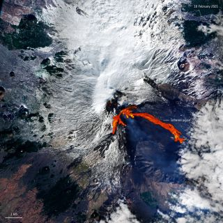 In this image taken from space, you can see Mount Etna in Italy, one of the most active volcanoes in the entire world, erupting. The image was captured Feb. 18 by the European Space Agency's Copernicus Sentinel-2 mission, which is made up of two different orbiting, Earth-observing satellites. The volcano erupted twice within less than 48 hours, spewing ash and spouting a fountain of lava, erupting Feb. 16 and then again Feb. 18.