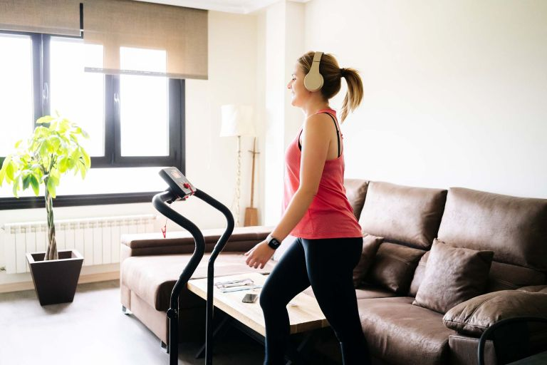 woman testing out one of the best treadmills in her living room