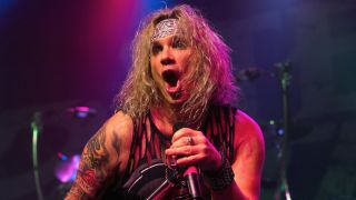 Steel Panther's Michael Starr singing onstage