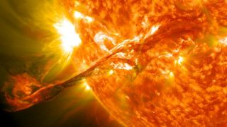 A solar storm, or coronal mass ejection (CME), erupts from the sun in August 2012.