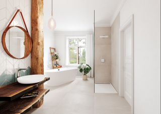 bright and airy bathroom design with freestanding bath