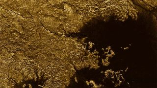Titan's Nile-like feature Vid Flumina, a network of steep-sided canyons filled with liquid hydrocarbons, is clearly visible un the upper left of this image from NASA's Cassini spacecraft.