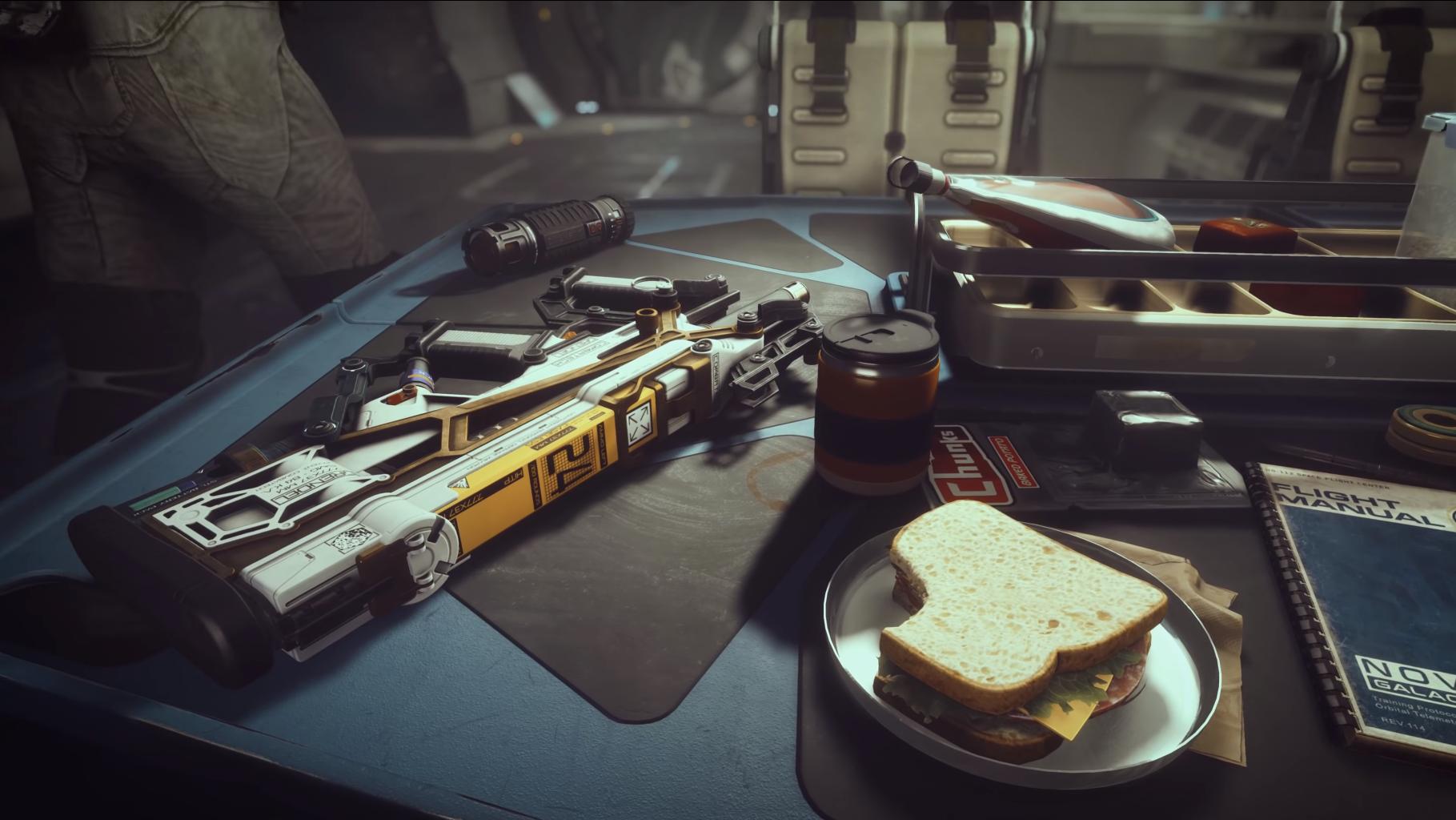 Starfield gun lying on a table beside a sandwich