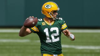 Aaron Rodgers hopes to lead the Green Bay Packers to the NFC championship game over the Los Angeles Rams Saturday, Jan. 16.