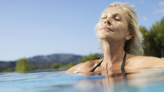 A woman relaxes in warm water during a hydrotherapy session