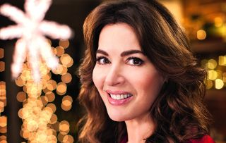 Christmas wouldn't be Christmas without Nigella slaving over a hot stove, dressed to the nines.