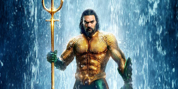 Jason Momoa as Aquaman in full costume and trident in 2018 DCEU film