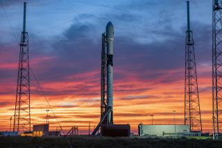 A SpaceX Falcon 9 rocket similar to the one seen here will launch a Canadian satellite that will beam ads from space in 2022 as part of a separate mission bound for the moon.