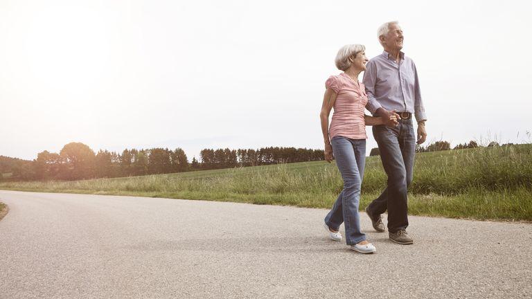 A senior couple walking along a path