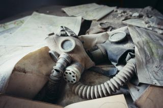A gas mask among papers in Chernobyl.